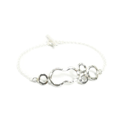 5. This asymmetrical Verve sterling silver bracelet is lively and it's moderate size allows you to layer with dainty chains.